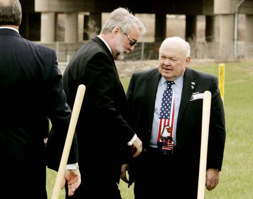 Aurora Mayor Tom Weisner, left, chats with Naperville Mayor George Pradel after breaking ground Wednesday on the Eola Road interchange at Interstate 88 that is expected to be done by the end of the year.