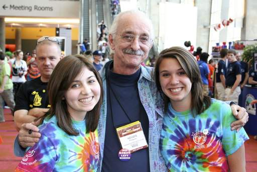 FIRST Robotics co-founder Woodie Flowers, a MIT professor, poses with two sophomore WildStangs team members, Lizzie Friedman, left, and Alyssa Zielinski.