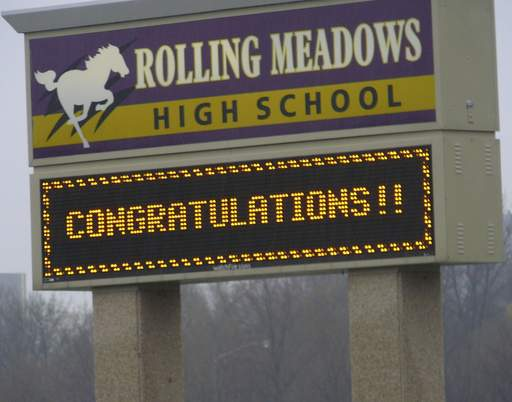 As parents await the Sunday night return from Atlanta of the Rolling Meadows High School WildStangs robotics team, the school sign flashes out an appropriate welcome.