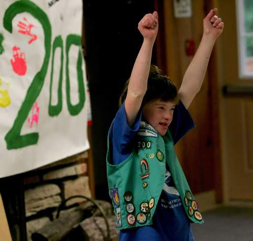 Laura Van Marm, 13, celebrates at the end-of-the-year celebration for Troop 200, a special-needs Girl Scout troop in Naperville.