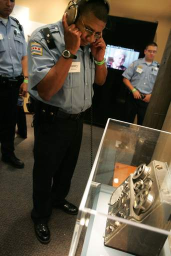 At the Holocaust Museum in Skokie, Chicago Police Officer Henry Morrison listens to some of the first audio recorded in Germany. He attended a two-day conference on law enforcement's role in Nazi Germany.