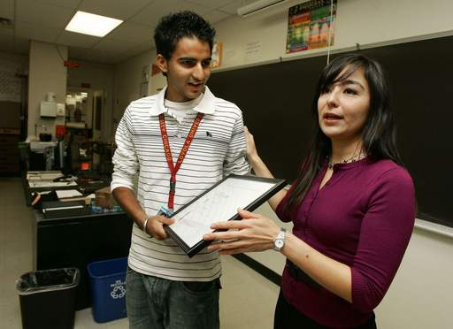 Ekamjeet Dhillon was surprised Monday at Palatine High School by Nordstrom representative Sandra Loza.