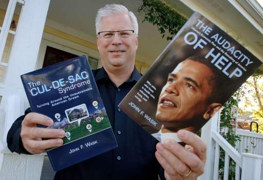Author John Wasik stands outside his Grayslake home with his latest books.