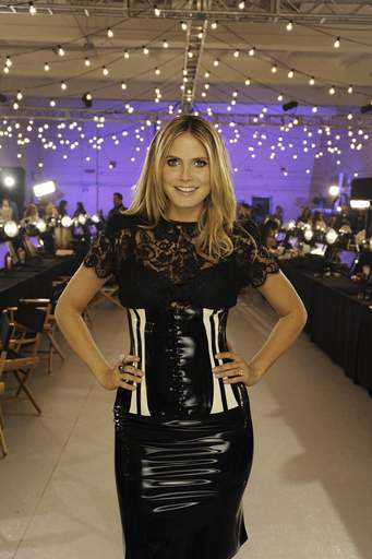 Fresh from her latest baby delivery, Heidi Klum puts in an appearance on