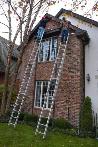 Holiday lighting services save homeowners from having to buy long ladders and the courage to climb them.