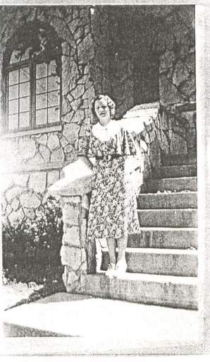 Longtime Lindbergh School teacher Anne M. Fox poses in front of the school in 1931. Fox Elementary School in Hanover Park is named in her honor.