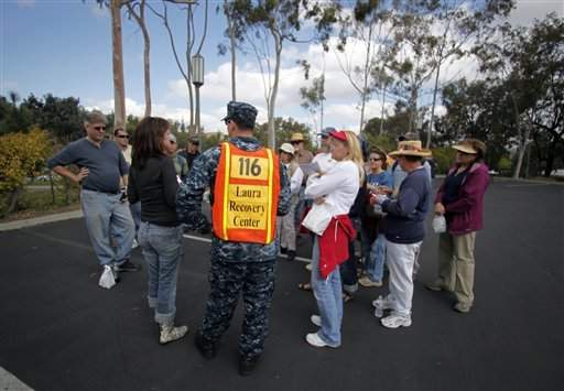 A team leader from the Laura Recovery Center in Texas talks to his search party before beginning their search around Lake Hodges for missing teenager Chelsea King, Tuesday.