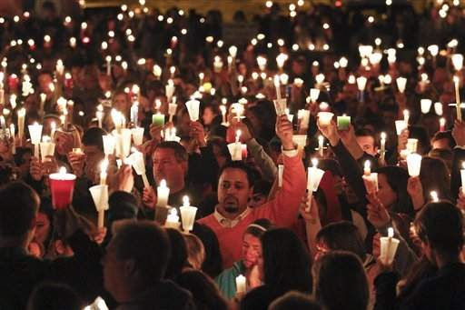 People hold candles during a candlelight vigil held at St. Michael's Catholic Church for missing teenager Chelsea King Tuesday in Poway, Calif. The body of the 17-year-old girl is believed to have been found five days after she went to a park for a jog.