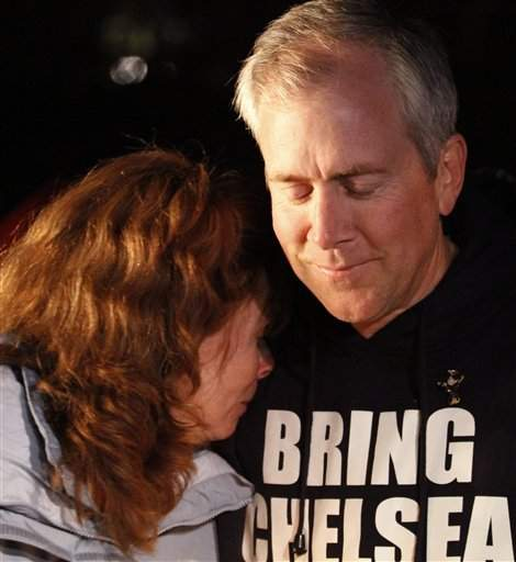 Brent King, right, and Kelly King, left, parents of missing teenager Chelsea King hug during a candlelight vigil held at St. Michael's Catholic Church Tuesday.