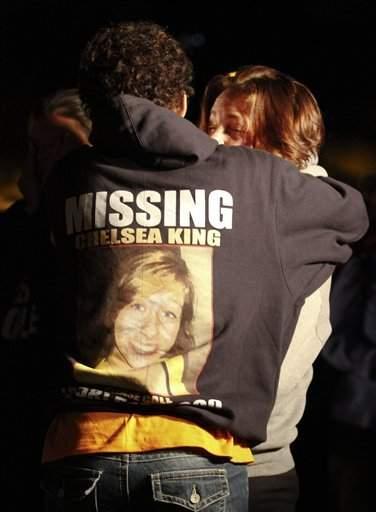 Two teenagers hug during a candlelight vigil held at St. Michael's Catholic Church for missing teenager Chelsea King Tuesday in Poway, Calif.