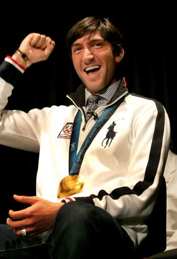 Evan Lysacek reacts to students' cheers as he returns to his alma mater Neuqua Valley High School in Naperville on Friday.