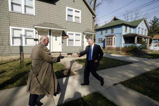 Elgin Mayor Ed Schock meets with U.S. Sen. Dick Durbin Tuesday. They were at 24 S. Porter at a house that is in foreclosure that the city is trying to purchase.