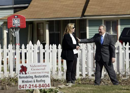 Katie Darling Bond of Elgin meets with U.S. Sen. Dick Durbin Tuesday morning. They were visiting homes bought with federal grants.