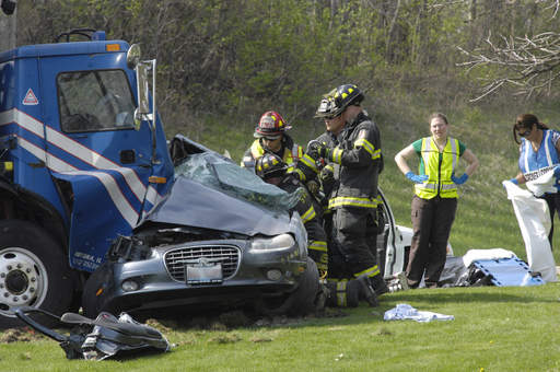 Sugar Grove firemen remove a victim from an accident on Route 47 near the entrance to Waubonsee Community College in Sugar Grove on Wednesday.