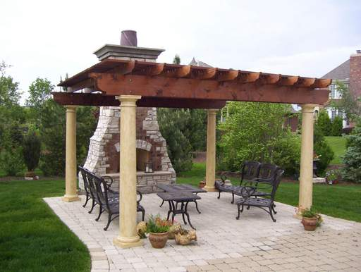 A pergola provides partial shade and makes for an elegant entertaining area at this home.