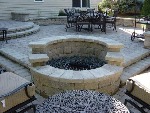 Outdoor fire pits, like this one by Crimson Design, can be hooked up to burn natural gas. At right, Archadeck built this gazebo, from which homeowners can enjoy their yard.