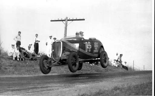 Frank Briscoe's Elgin Piston and Pin Special car goes airborne at nearly 95 mph on