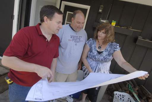 Building contractor Daniel Murphy, right, discusses a room addition with homeowners Dave and Rayelynn Damitz of Schaumburg. Murphy owns Murph's Custom LLC in West Dundee.