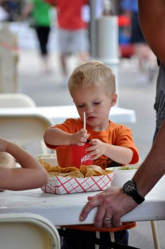 Anderson Knight, 2, scores a refreshing slushy at the Taste of Arlington Heights Saturday evening.