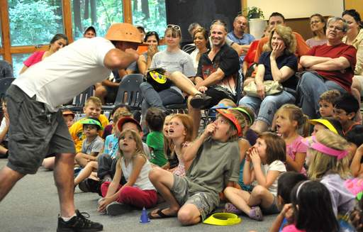 Tony The Bug Guy gets his audience worked up during his class at the first-annual Bug Fest in North Aurora Saturday.