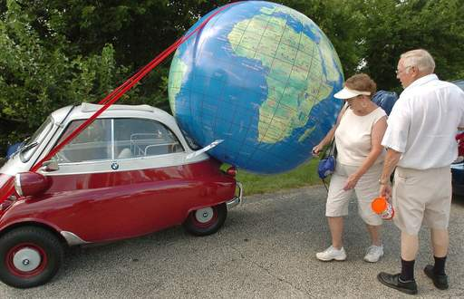 Margaret and Jim Fohr check out a BMW Isetta 300 that inexplicably has a globe attached to it at the first-ever Micro/Mini Car World Meet in Crystal Lake.