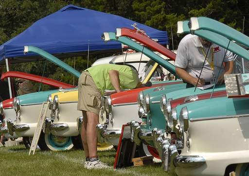 Car judge Bill Schaefer, left, gets a closer look at a 1959 Nash Metropolitan at the Micro/Mini Car World Meet in Crystal Lake.