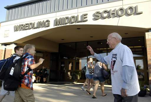 Wredling Middle School namesake John Wredling greets students before the first day of school for district 303 in St. Charles Wednesday. Wredling, 96, is a former superintendent of the district.
