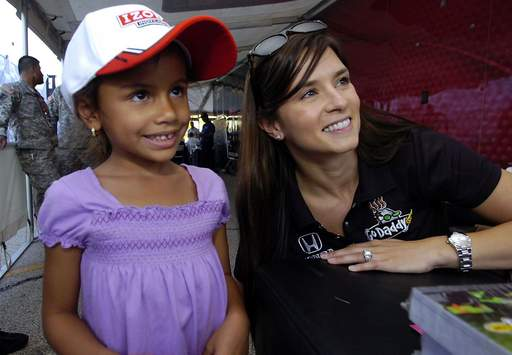Indy race fan Yeneliz Delmoral, 5, of Schaumburg cracks a smile as she has her picture taken with race car driver Danica Patrick at the autograph session at Woodfield Mall in Schaumburg.