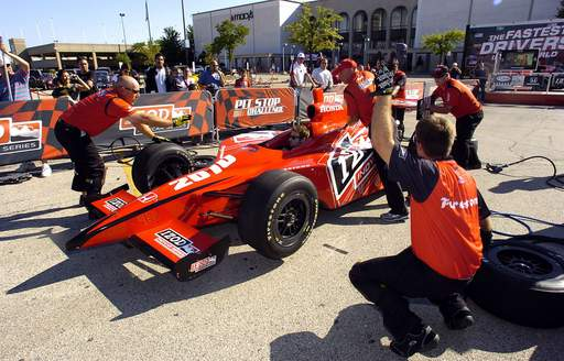 The Indycar Pit Stop Challenge takes place in the parking lot of the Woodfield Mall as part of the session for fans on Thursday.