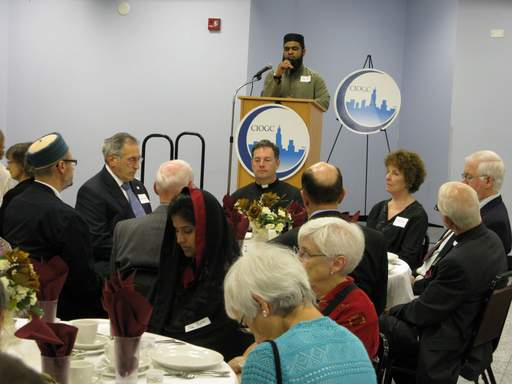 Muhammad Ilyas recites an Islamic prayer from the Quran during an interfaith iftar, or fast-breaking meal, at the Islamic Community Center of Des Plaines Tuesday.
