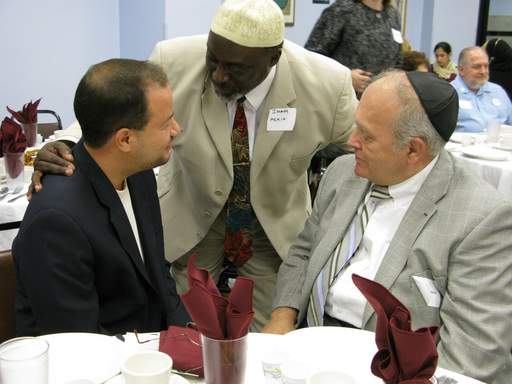 From left, Zaher Sahloul, chairman of the Council of Islamic Organizations of Greater Chicago, Imam Ghais Askia of The Ministry of the Faithful to G-d in Chicago, and Ben Goldstein, chaplain for Illinois Masonic Hospital were attend an interfaith iftar.