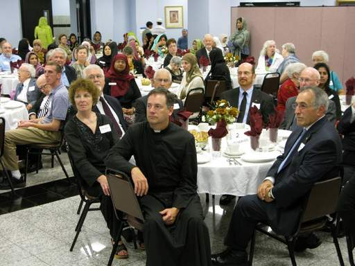 Des Plaines Mayor Marty Moylan, right, was among a crowd of more than 300 representing area Islamic, Jewish,  and Christian communities who attended the 10th annual Interfaith Unity Iftar.