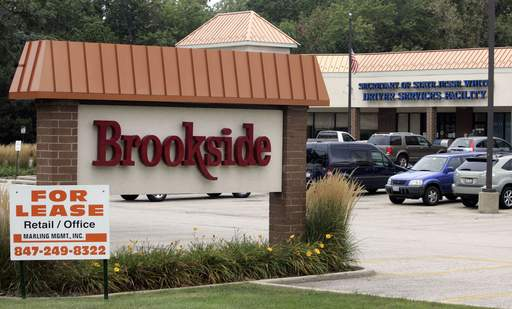 The state owes nearly $43,000 in rent and expenses for the secretary of state facility in the Brookside shopping center in Libertyville, the landlord claims.