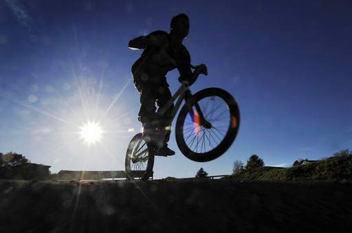 Chris Gayitan, 16, of Carpentersville, practices riding his BMX bicycle on The Hill BMX track in the Elgin Sports Complex Wednesday. He said it was only his fourth time at the facility and he wants to start racing there soon.