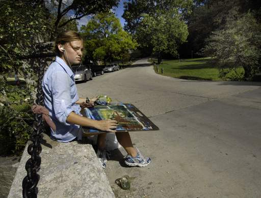 Morgan Kimball, a sophomore visual communications student at Judson University, paints a landscape of the Elgin campus Tuesday.
