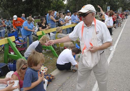 Mayor Al Larson hands out candy to kids at the Schaumburg Septemberfest Parade Monday morning on Summit Drive.