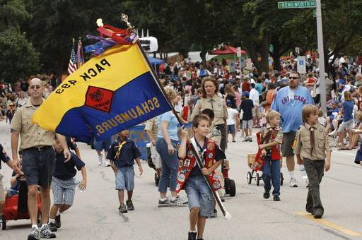 Cub Scout pack 493 marches to a big crowd in attendance Monday at the Schaumburg Septemberfest Parade.