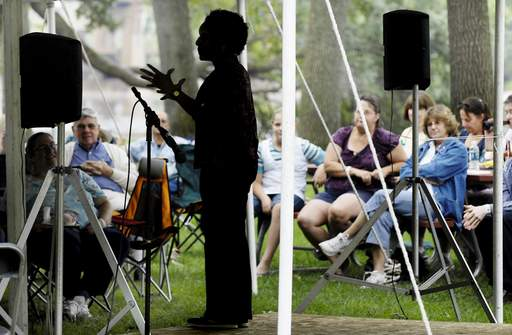 Storyteller Linda Gorham entertains a relaxed crowd Monday at the Fox Valley Folk Music and Storytelling Festival in Island Park in Geneva.