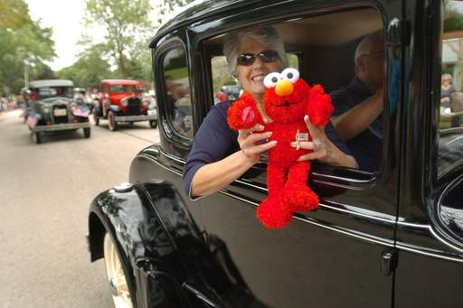 Carol and Neil Cloe of Grayslake, with Elmo in tow, drive their Ford Model A in the Buffalo Grove Days parade. They're members of the Chain O' Lakes Model A Club in Antioch.