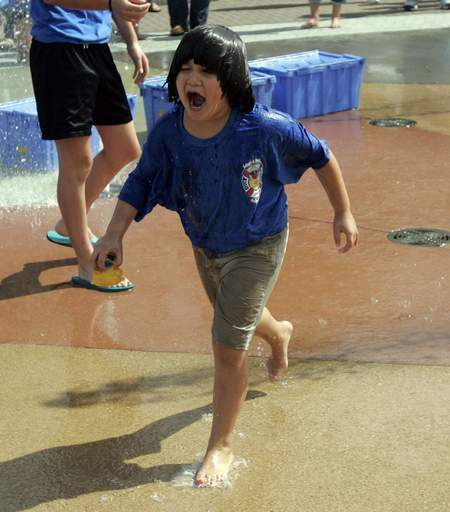 Completely soaked, Myka Suarez, 6, of Elgin makes her way to turn in her duck during the Duck Pluck 2010 at Festival Park in Elgin Saturday, September 11, 2010. The event was a fundraiser to benefit the Boys and Girls Club of Elgin.
