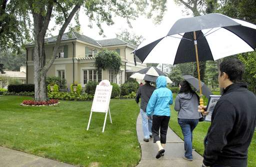 Visitors approach the home at 223 N. Worth Ave, part of the Gifford Park Association's 29th-annual Historic Home Tour. The home was built in 1923 by architect Ralph E. Abell.