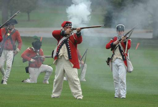 Reenactors portray British soldiers during the Revolutionary War reenactment at Cantigny in Wheaton Saturday.