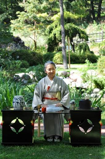 Janet Nakai, a student of Joyce Kubose who teaches this ceremony out of her house in Chicago, performs a demonstration of the traditional tea ceremony at the Japanese Gardens in Geneva Sunday afternoon.