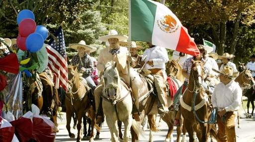 West Chicago's Mexican Independence Day parade makes its way through downtown Sunday in West Chicago.