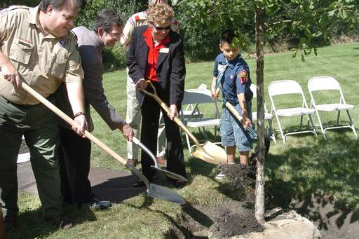 From left, Matt Ackerman, Chris Manheim, Betsy Penny, and Nathaniel Engel end the St. Charles Tree Planting Ceremony by tossing in the first shovels of dirt Friday afternoon.