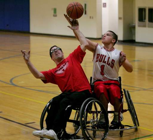 Joe Gerardi, left of Addison and Kyle Gribble, 14, right of Hoffman Estates, with the Chicago Wheelchair Bulls practice at the Northeast DuPage Special Recreation Association in Addison.