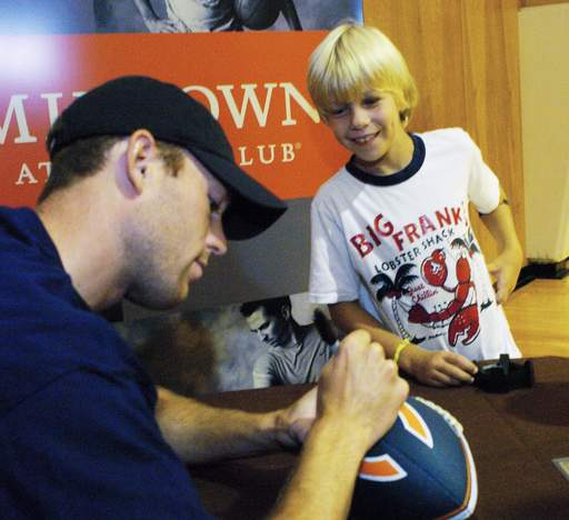 Chicago Bears kicker Robbie Gould signs an autograph for Nathan Quint, 9, of Long Grove at the Midtown Athletic Club in Palatine Tuesday.