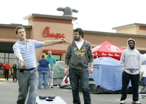 Kevin Feldkamp of Cincinnati, Ohio, left, and Conor McLaughlin, right of Naperville spend time playing bags in preparation for the grand opening of the first Chick-Fil-A restaurant in the Chicago area, located on the Rt.59 side of the Fox Valley Mall.