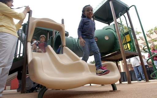 Lisa Odebode, 4, of Prospect Heights plays on the slide section of the playground equipment during the grand opening at the Wheeling Park District Preschool on Wednesday.