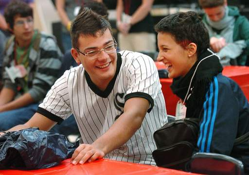 Italian exchange student Nicolo Zuffellato, left, wearing a shirt he got at a White Sox game Sunday, and fellow student Beatrice Bovo, share a laugh while visiting South Middle School in Arlington Heights during a meet and greet for the exchange students.